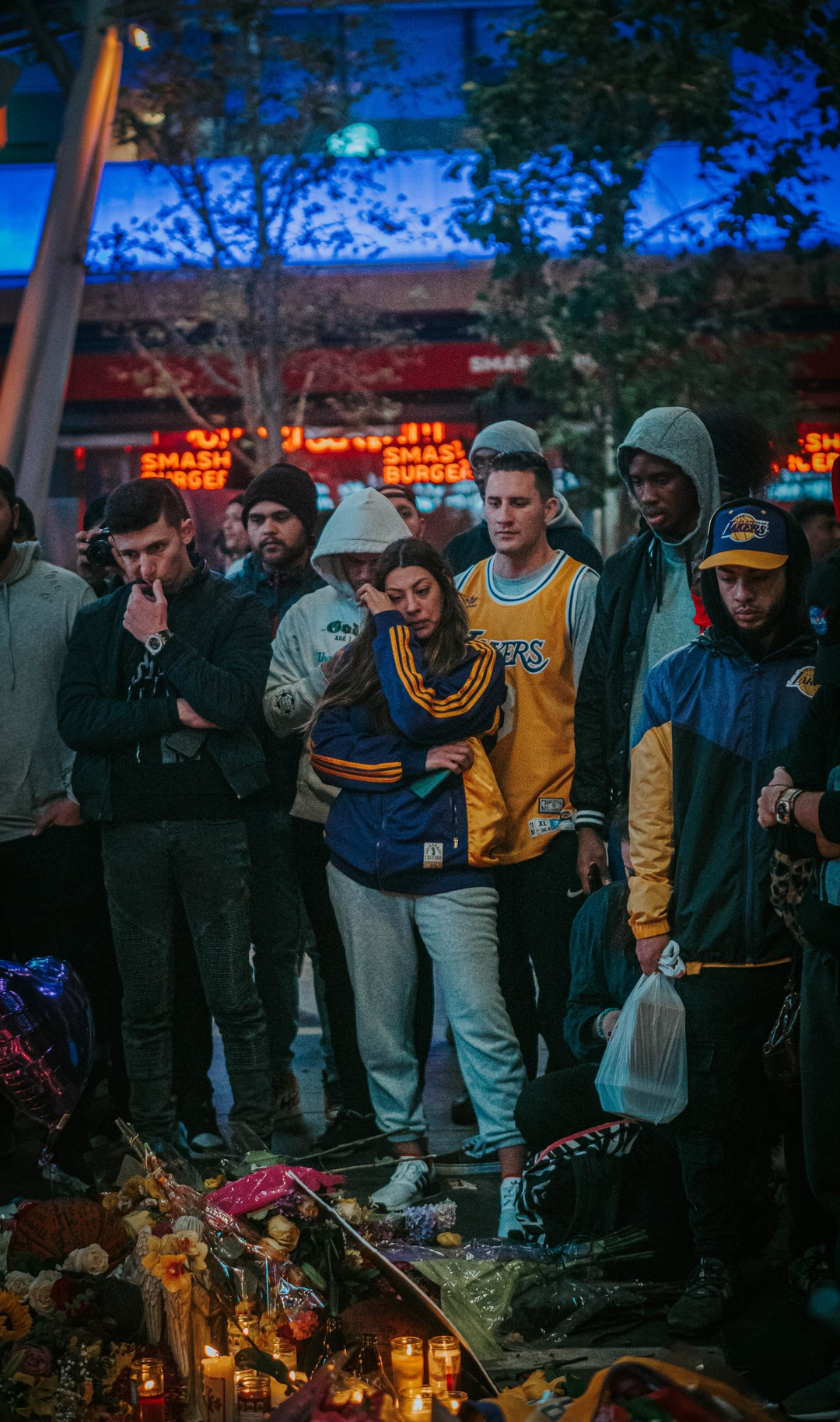Fan's mourn Kobe Bryant's death at a vigil at Staples Center on January 26th, 2020.