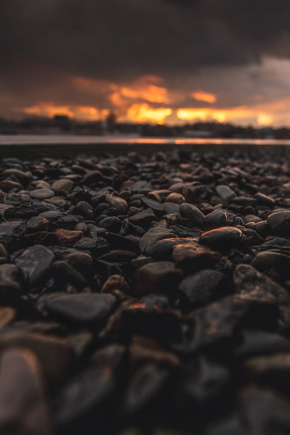 Black Stones On The Beach During Sunset
