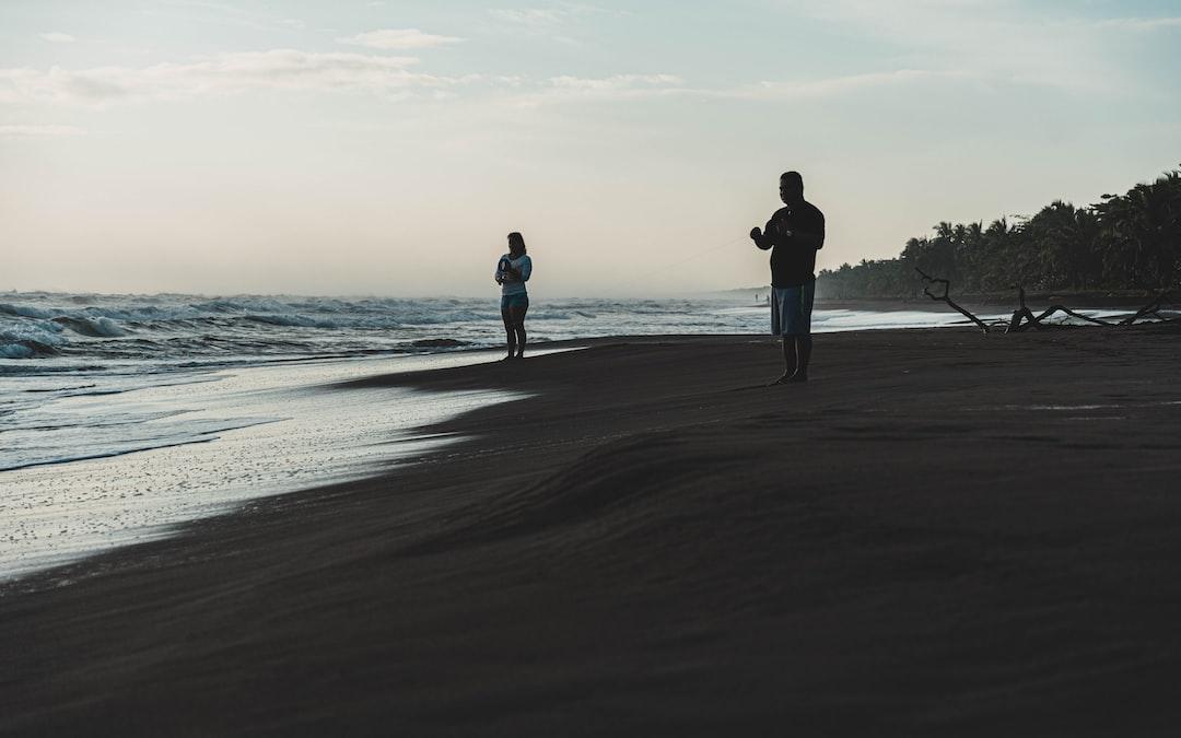 Fishermen at work just after sunrise at Tortuguero beach, Costa Rica