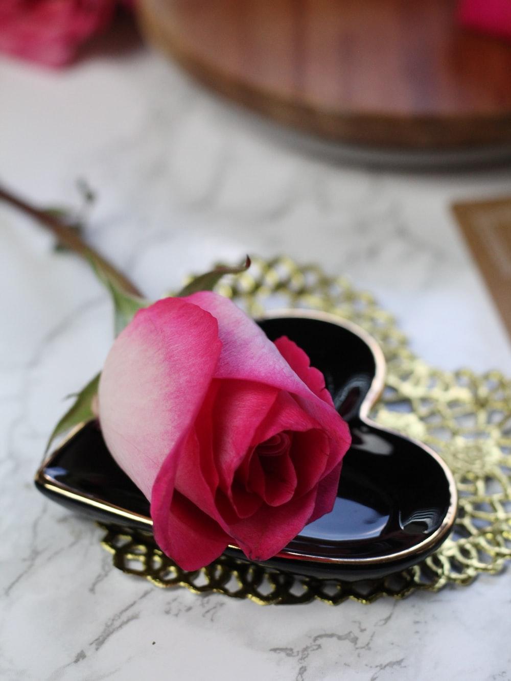 pink rose on gold ring