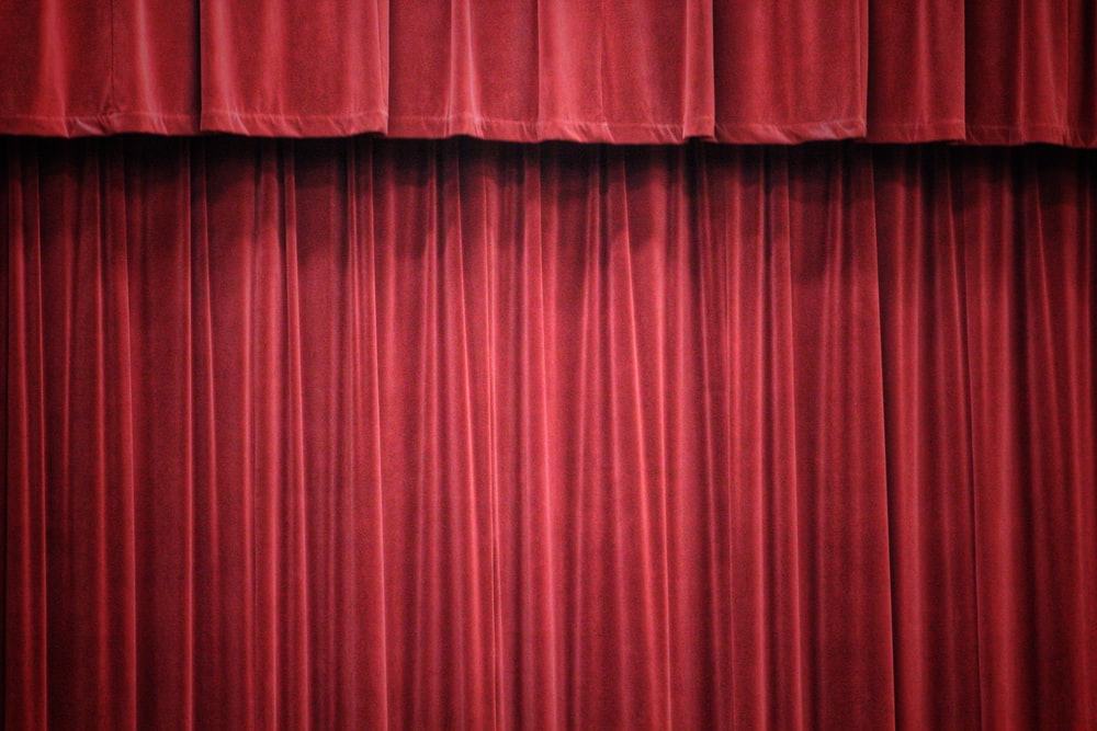 red curtain on white wall