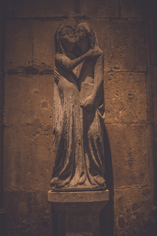 brown concrete statue of a woman