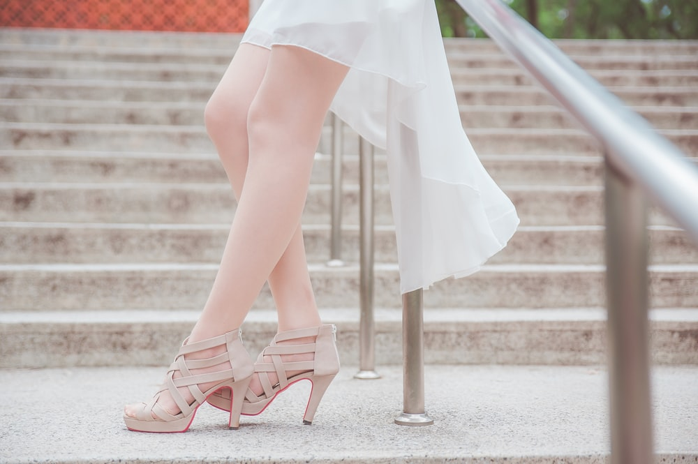 woman in white dress and pink peep toe sandals