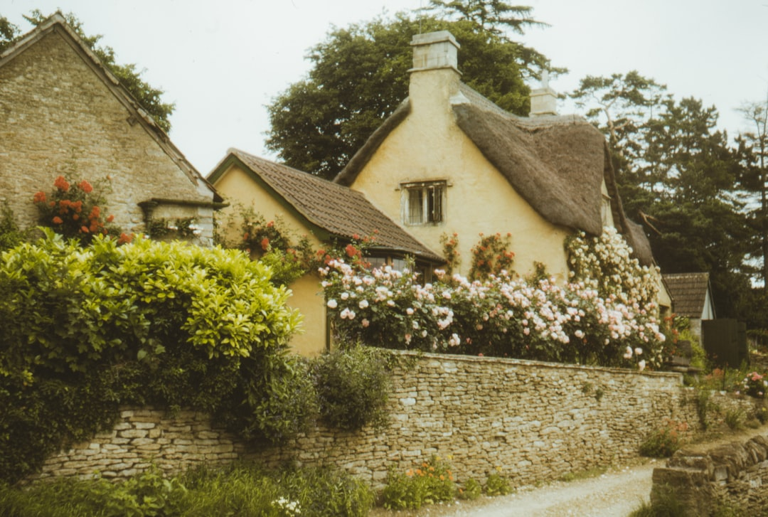 1965 film photo of a quaint English village , Castle Coombe