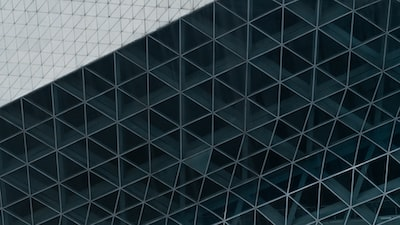 blue and white glass walled building triangle zoom background