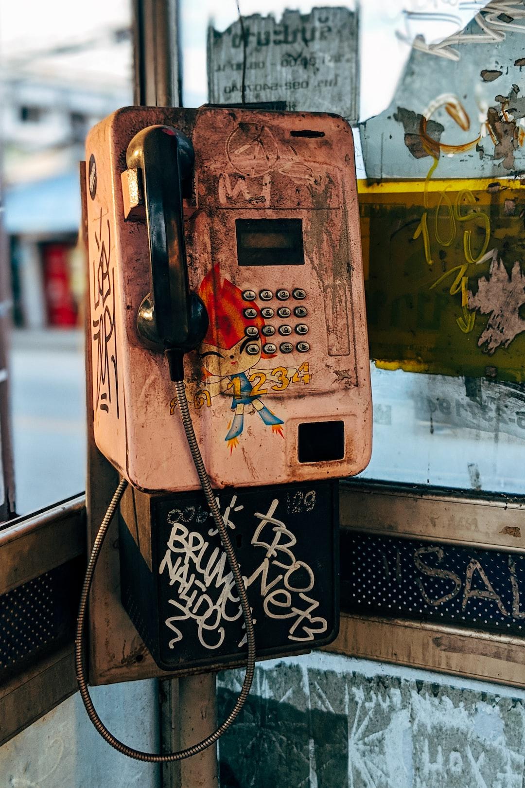 Beat-up public phone in Thailand