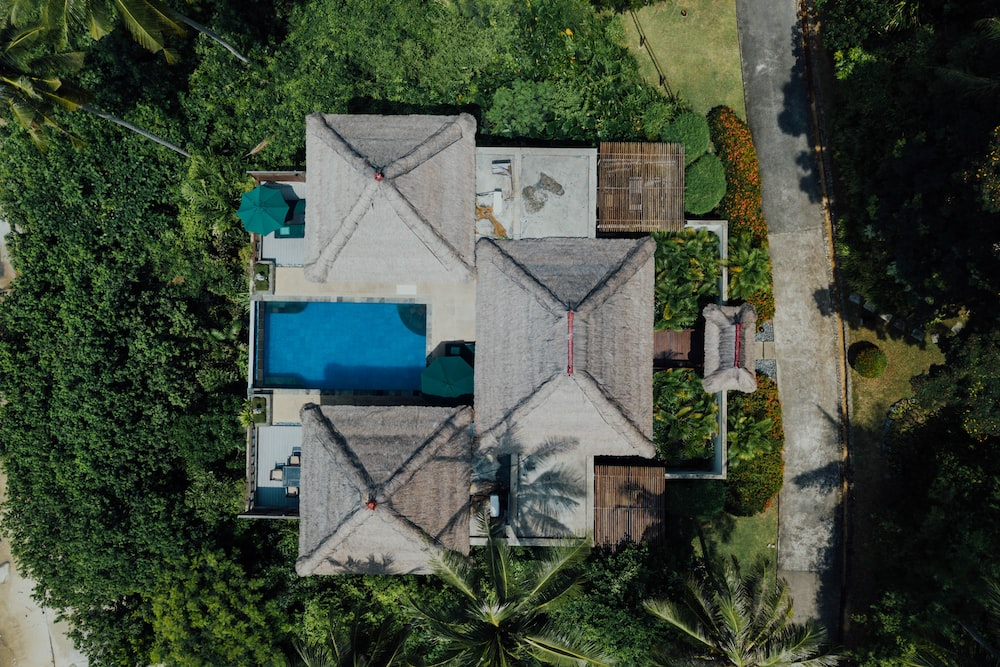 aerial view of white and blue house
