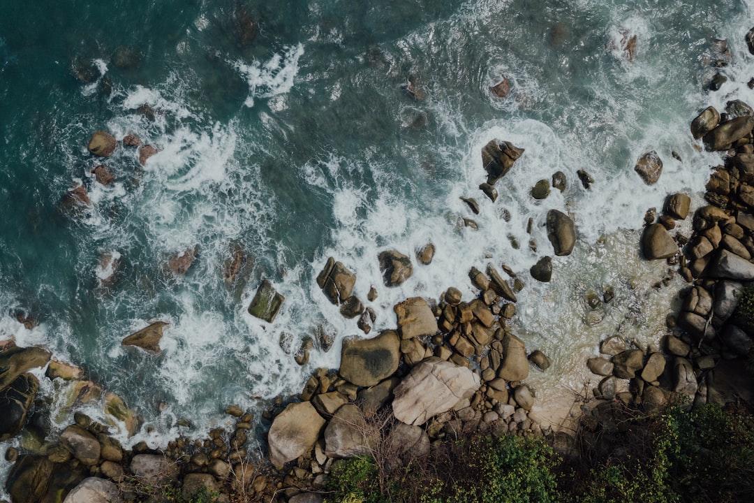 Brown Rocks On Seashore During Daytime - unsplash