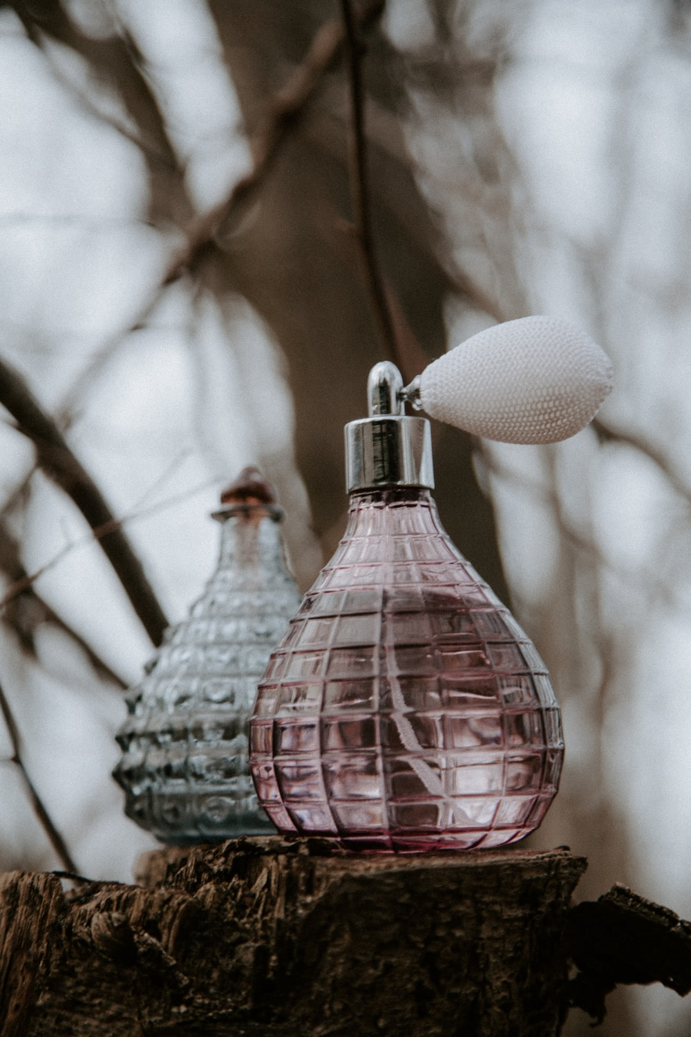 pink and white glass bottle