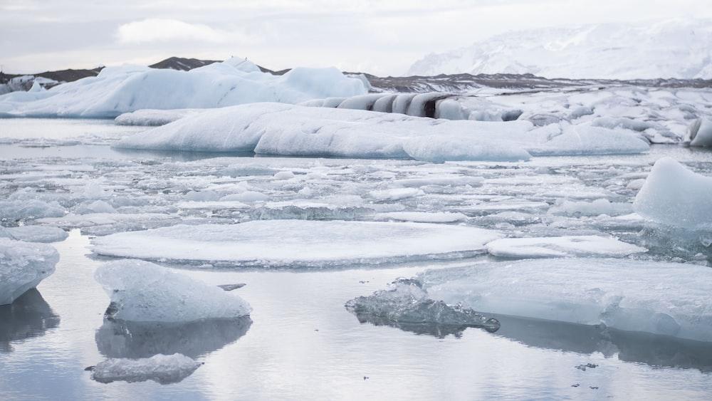 ice blocks on body of water