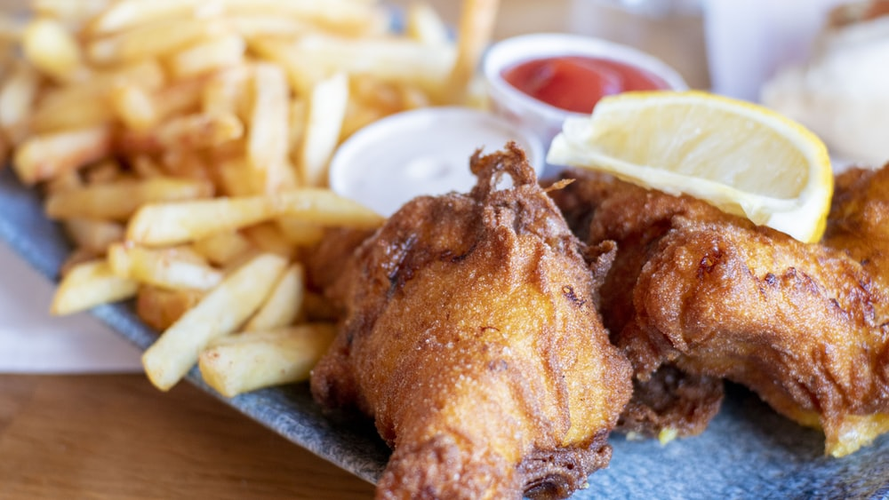fried chicken with fries and sauce
