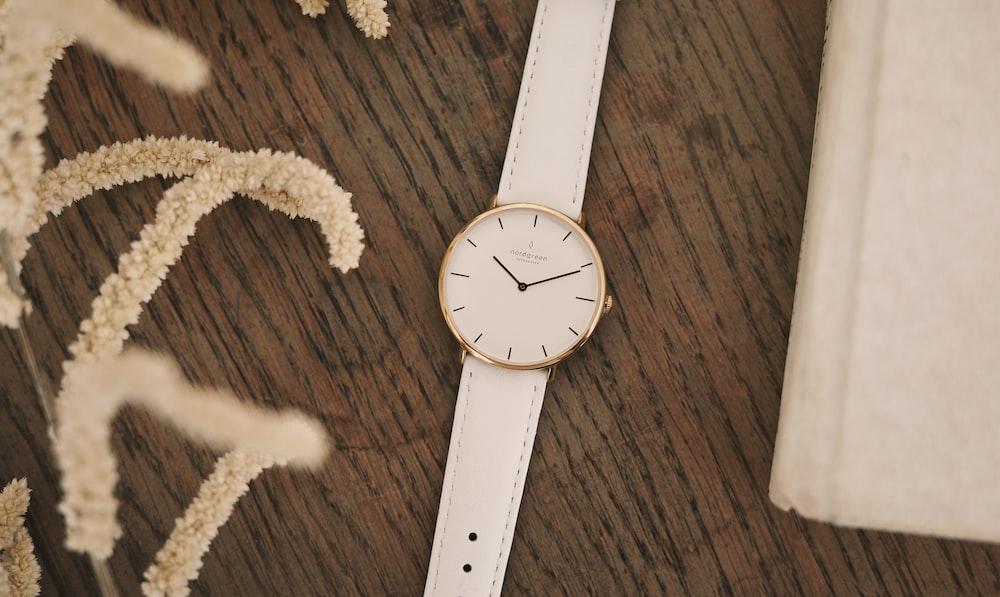white round analog watch at 10 10
