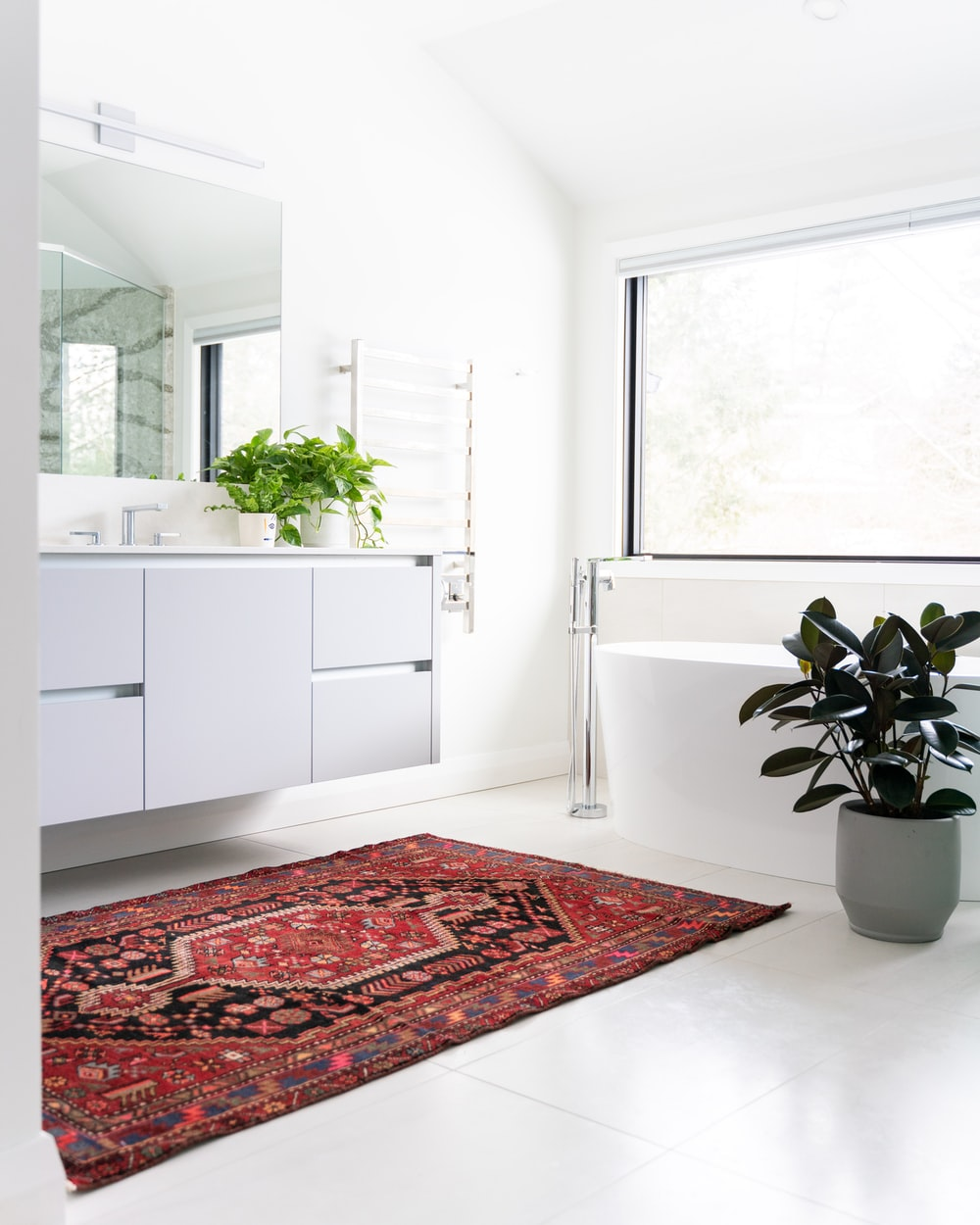 green potted plant on white wooden cabinet