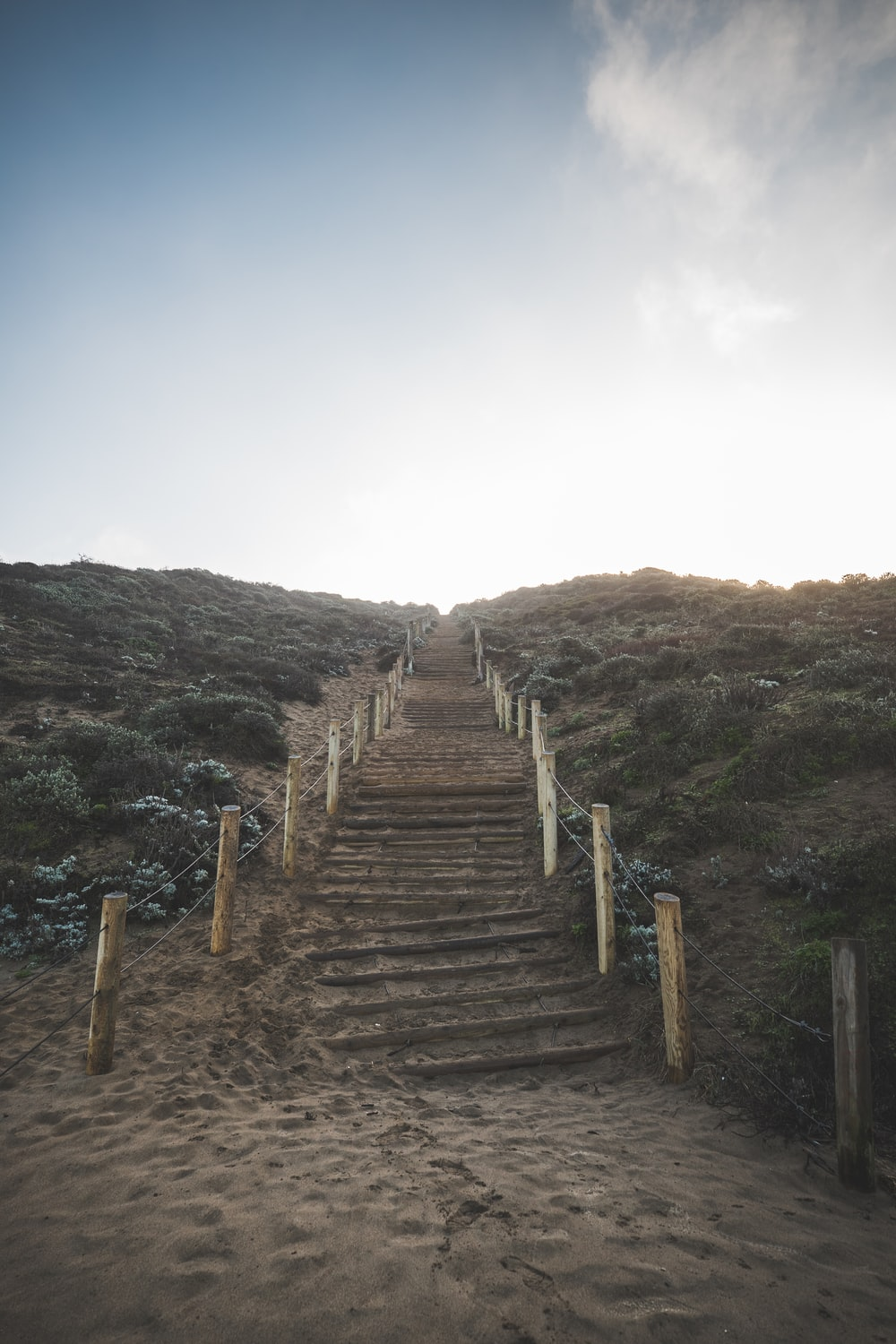 brown wooden stairs on mountain during daytime