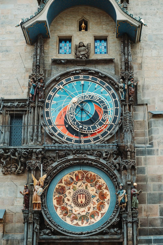 brown and black round analog clock at 10 00
