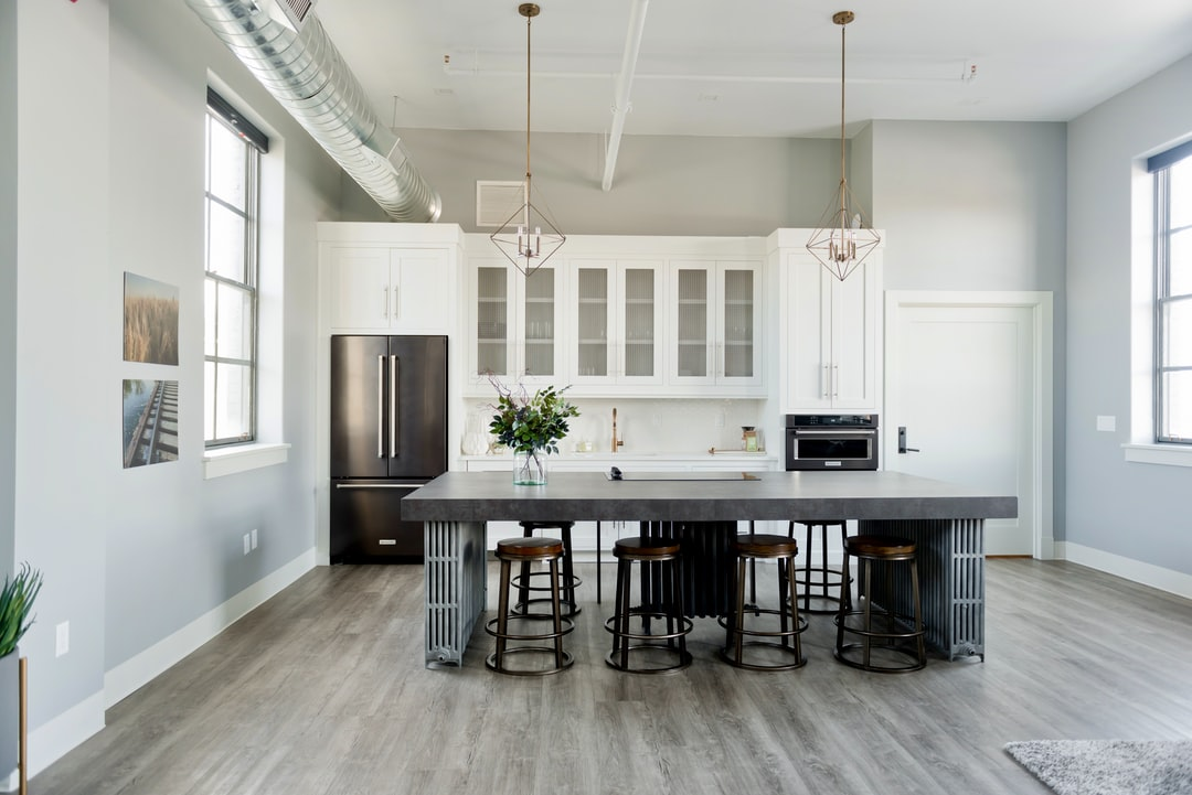 Modern Kitchen Design with industrial island, decor and fixtures.   Flats Luxury Suites at 22 East Center Street in Logan, Utah  https://www.instagram.com/AwCreativeUT/ https://www.awedcreative.com/ https://www.awcreativeut.com #AwCreativeUT #awcreative #AdamWinger Adam Winger