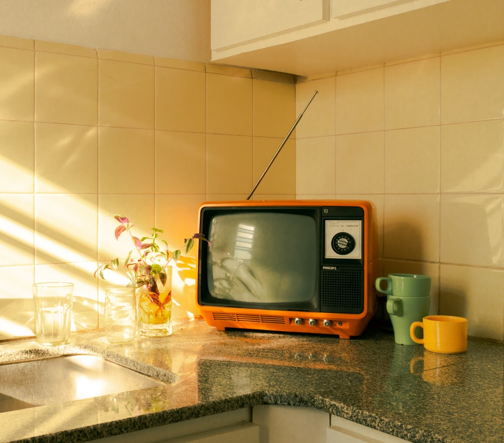 brown and black crt tv