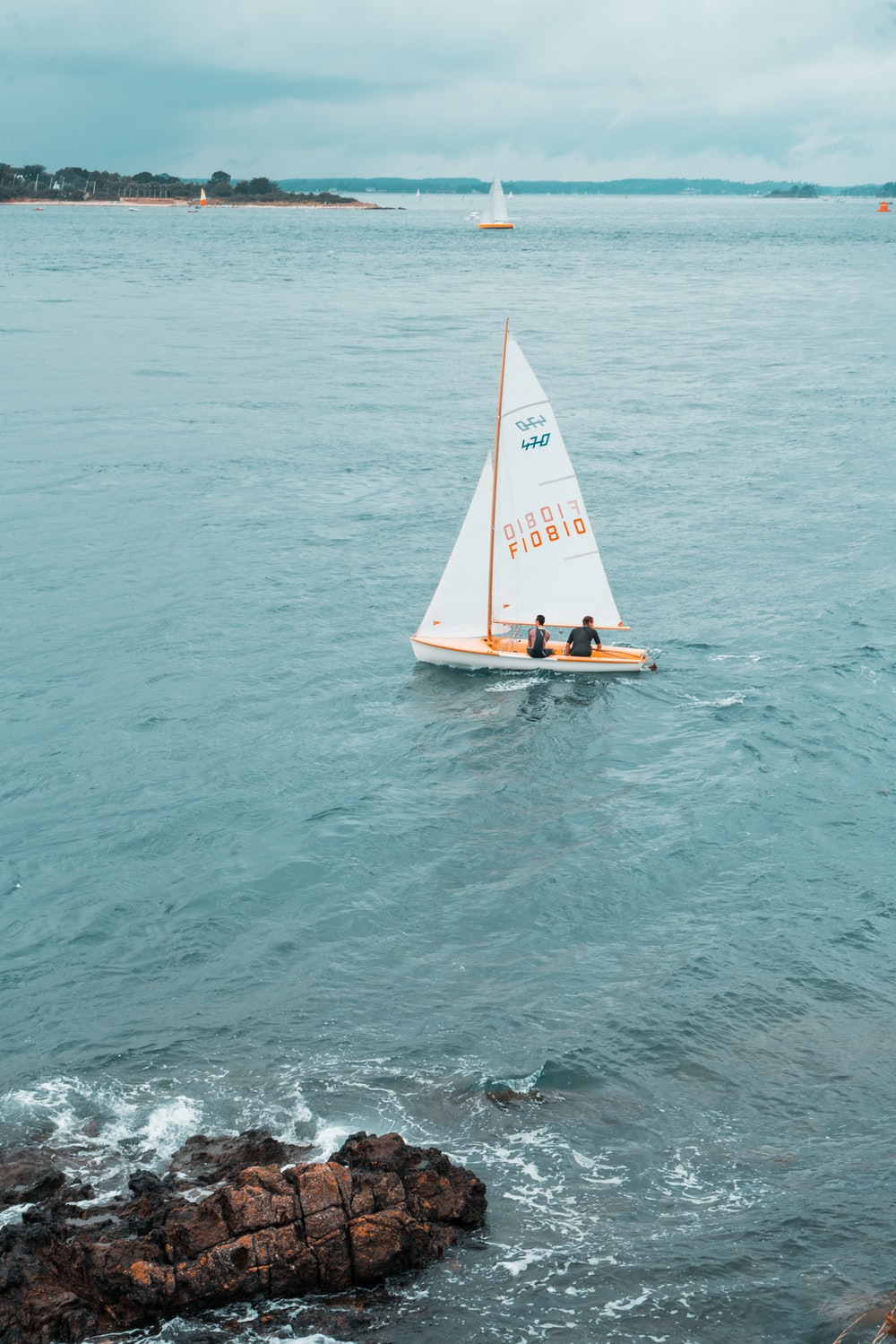 white and brown sailboat on sea during daytime
