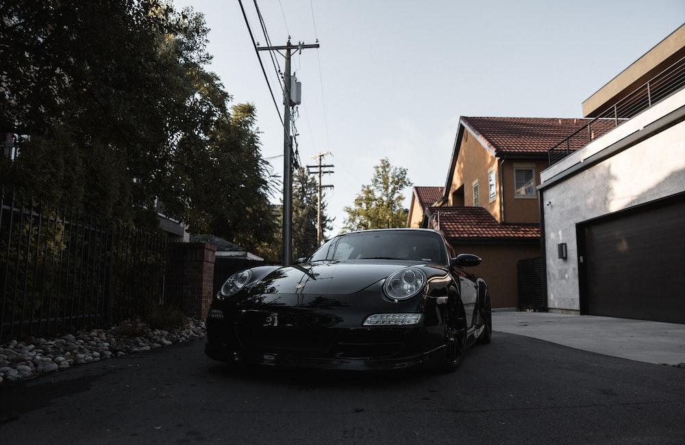 black bmw m 3 parked on sidewalk during daytime