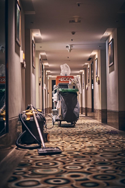 black and gray stroller on hallway