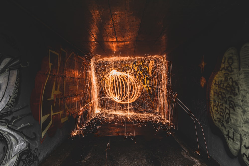 brown metal tunnel with light