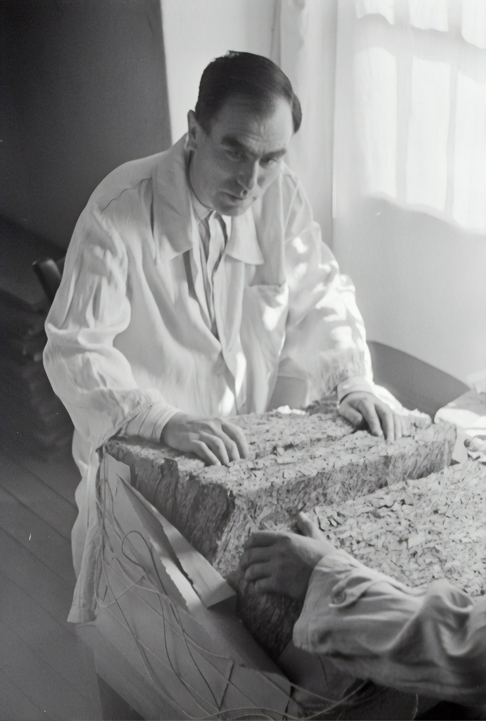 man in white thobe sitting on bed