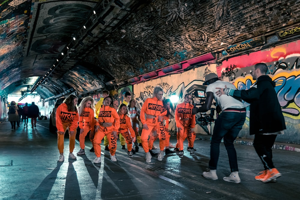 group of people in orange and white shirts