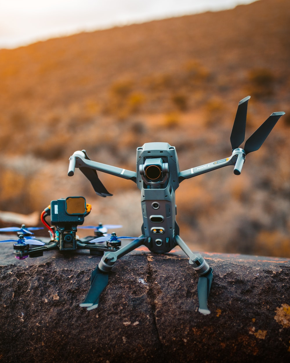 gray and black drone on brown rock during daytime