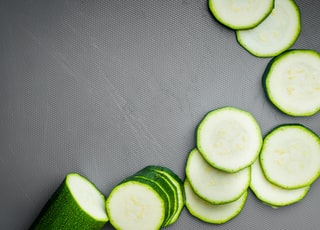 sliced cucumber on gray textile