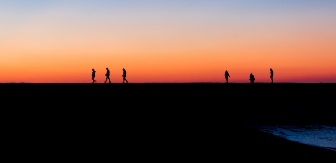 """/ Sunset Walkers.  This is my favourite photo i ever took, cause it was the first time i was able to """"carpe diem"""". This group of friend was leaving as soon as the sun was setting, and here's the story of how i got lucky to """"freeze"""" them in time."""