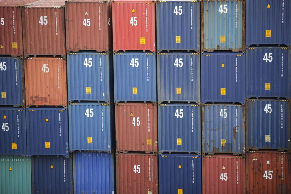 stack of red and blue intermodal containers