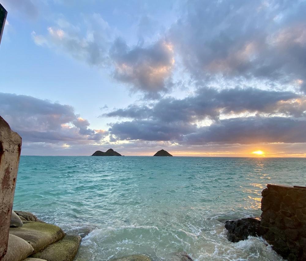 ocean waves crashing on rocks during sunset