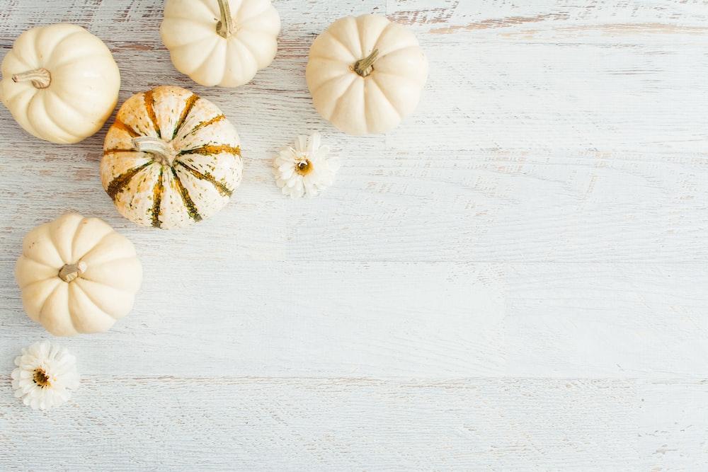 white garlic on white wooden table