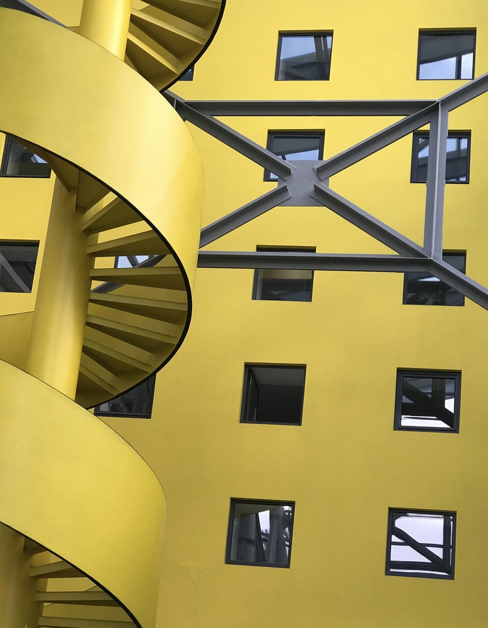 yellow and black spiral staircase