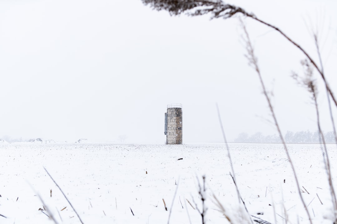 grain silo in a snowy field