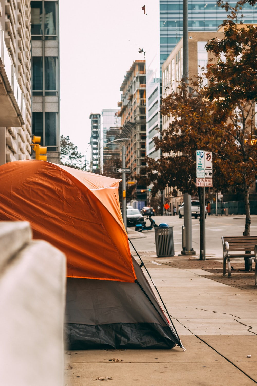 orange umbrella on sidewalk during daytime
