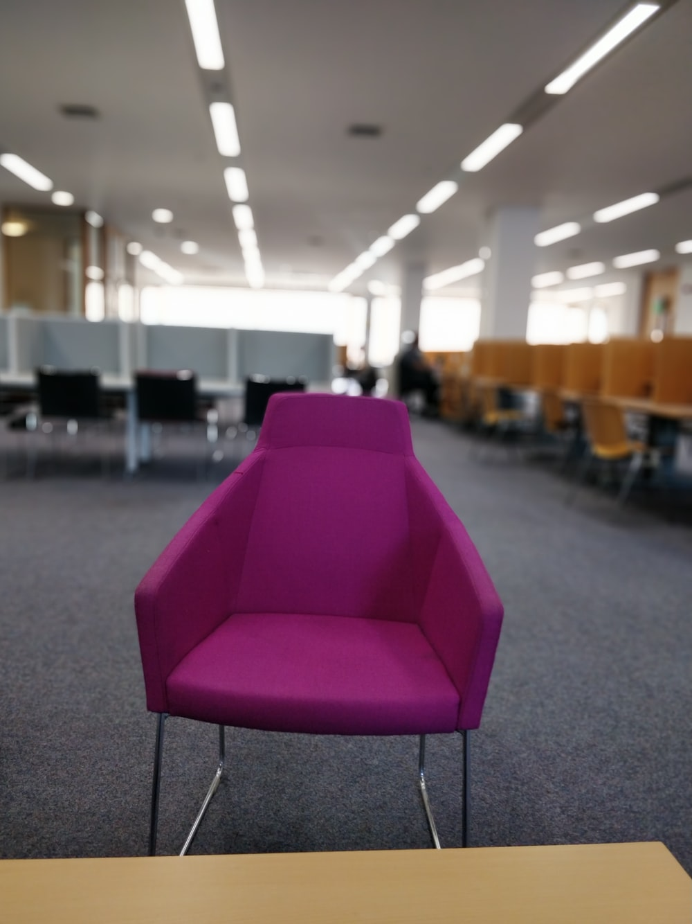 purple chair on gray carpet