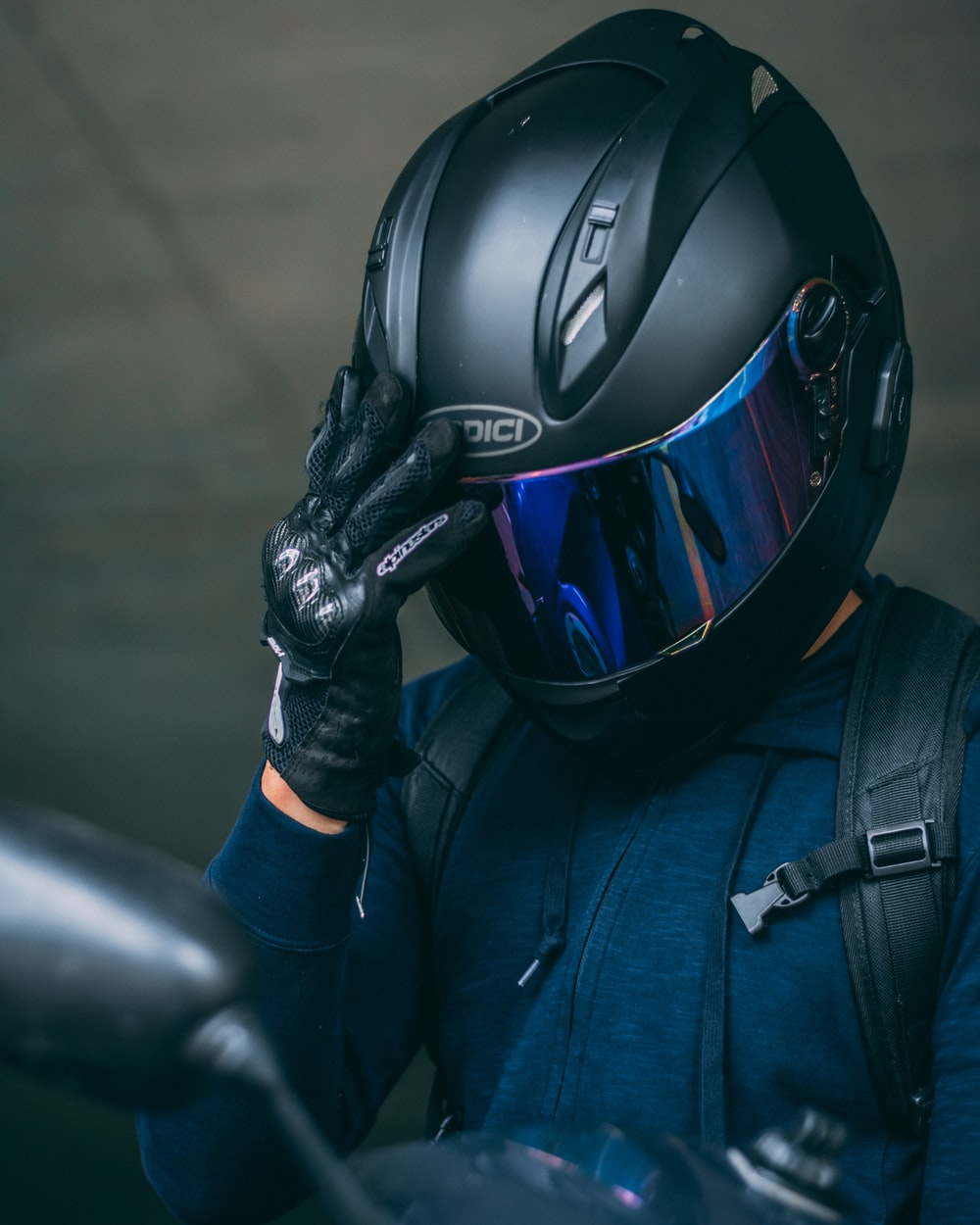 person in black helmet and blue jacket