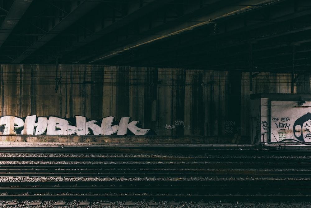 white textile on train rail