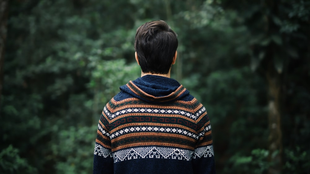 woman in blue brown and white tribal print sweater