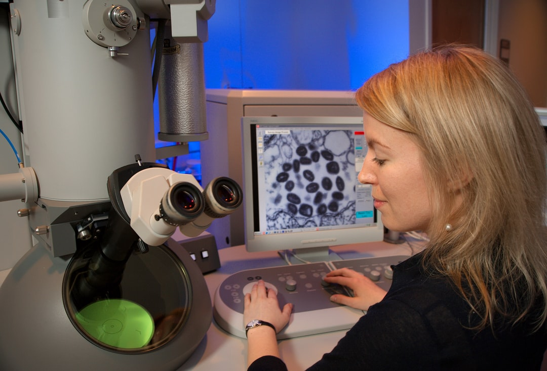 This Image Depicts Centers For Disease Control and Prevention (cdc) Intern, Maureen Metcalfe, As She Was Using One of the Agency's Transmission Electron Microscopes (tem). the Microscope's Screen Was Displaying A Thin Section of the Variola Virus, Rev - unsplash