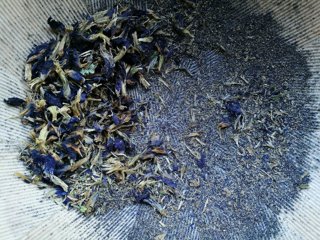 BLUE FOR YOU | dried blue flowers partly grounded into a powder in a suribachi - a Japanese mortar