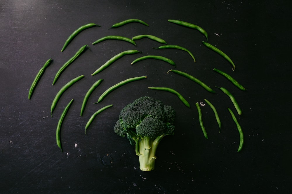 green broccoli on black surface