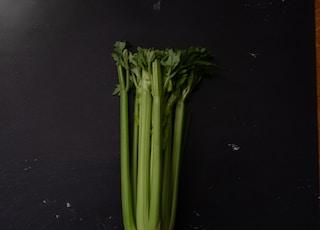 green vegetable on black table
