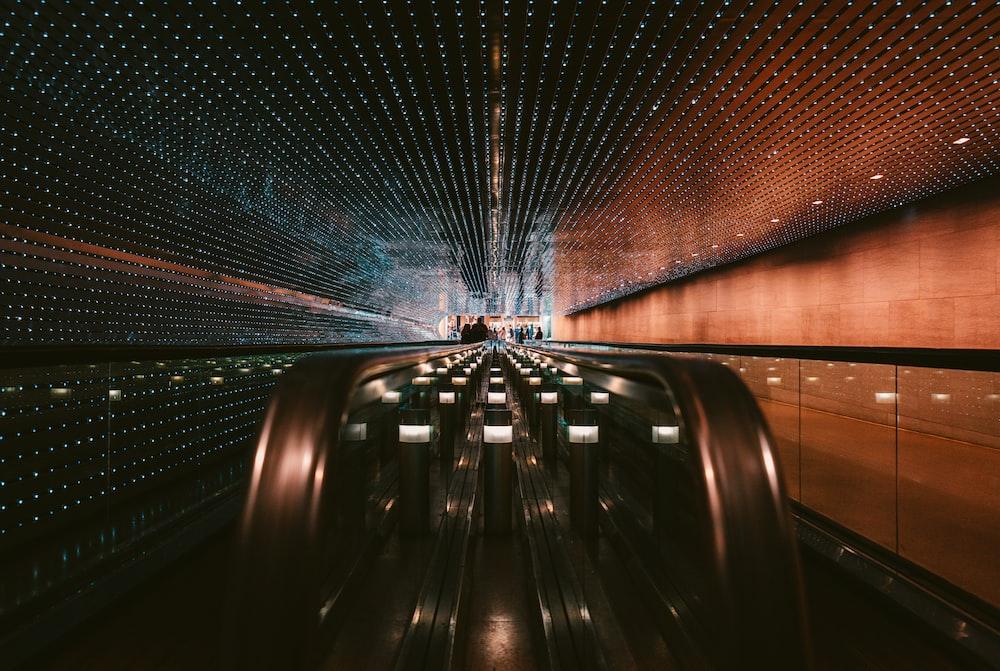 black escalator in a tunnel