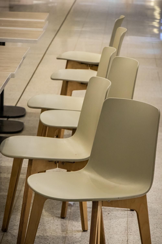 white plastic chairs on white floor tiles