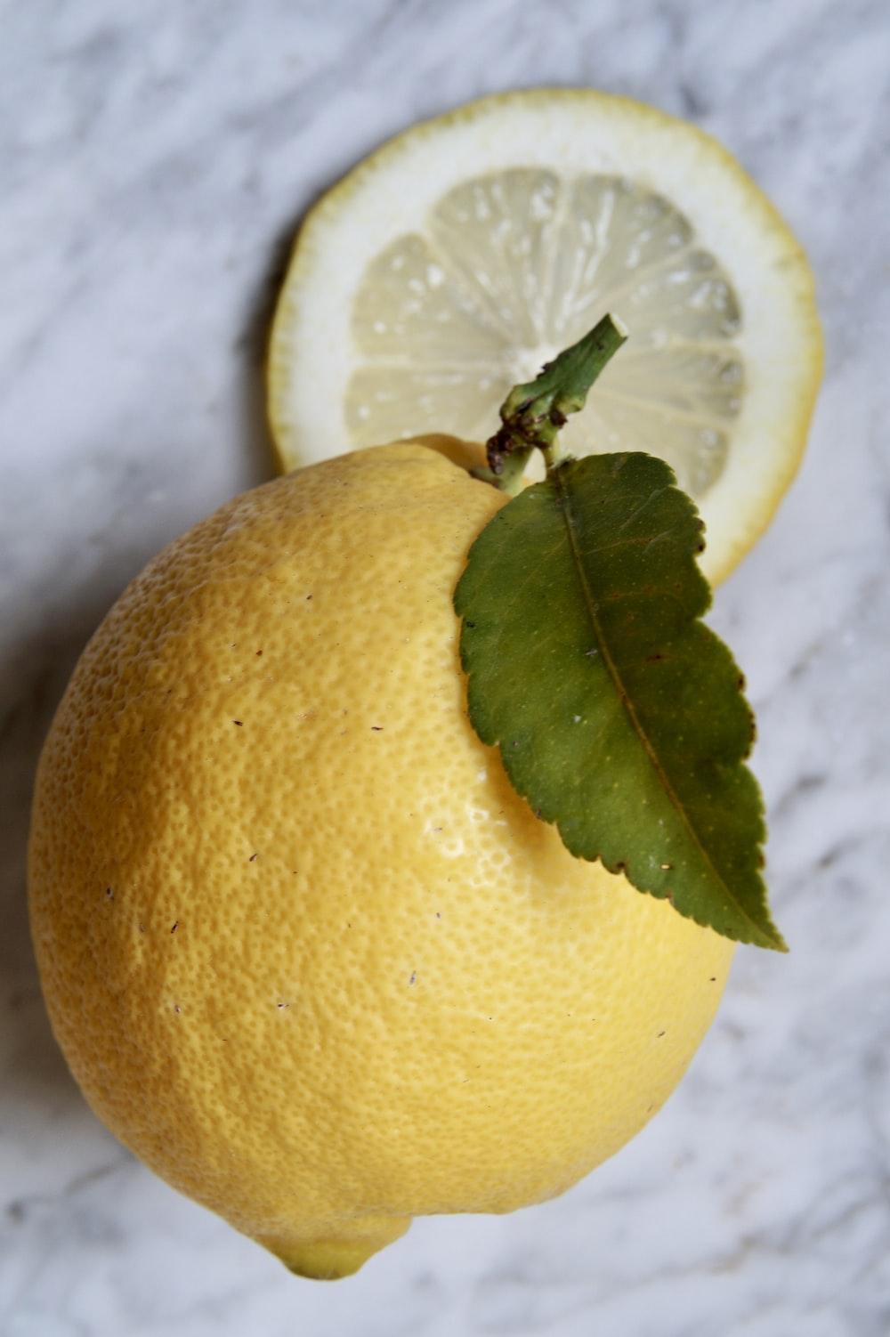 yellow lemon fruit on white textile