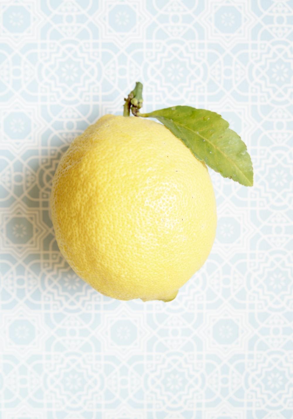 yellow lemon fruit on white and blue textile
