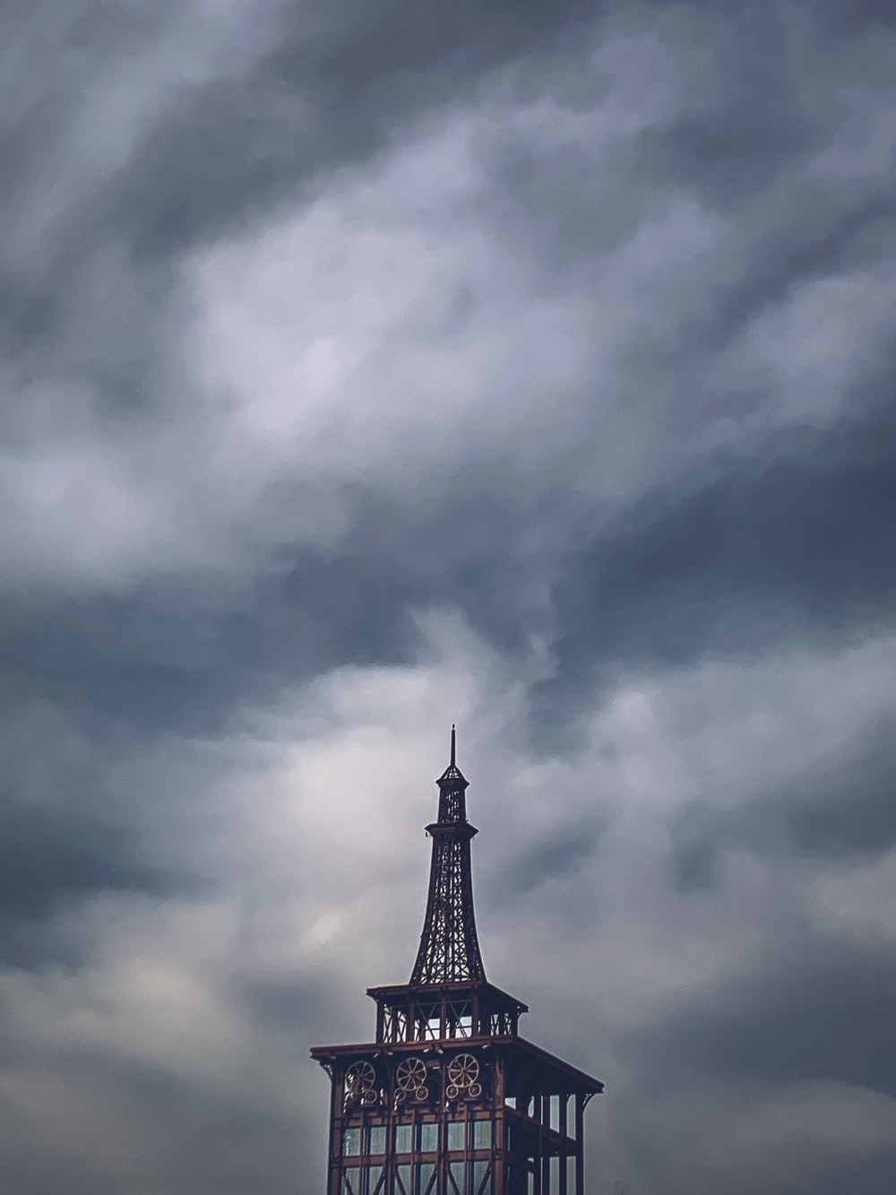black tower under gray clouds
