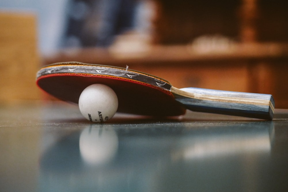 white golf ball on blue table